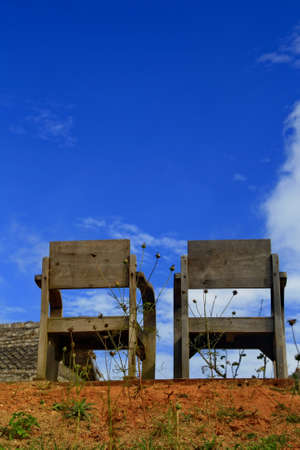 lovelorn: Two old wood chair with blue sky