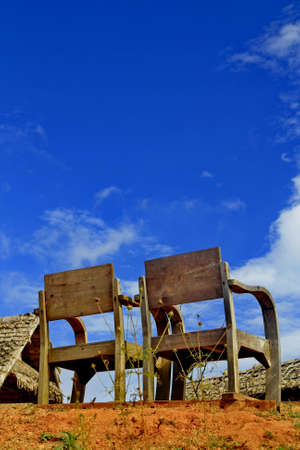 Two wood chair in countryside and blue sky Stock Photo - 8816809