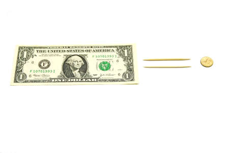 US dollar bill equal small gold coin Stock Photo - 8816828
