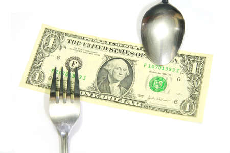 smacker: A spoon and a fork on US dollar bill ,eat profit