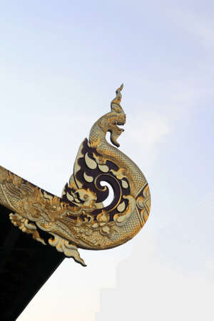 snakes and ladders: Big thai gold  great Naga in temple roof with sky Stock Photo