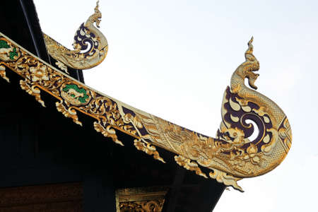 snakes and ladders: Big thai gold  great Naga in temple roof  Stock Photo