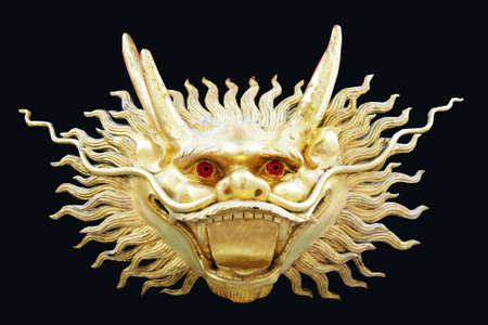 golden religious symbols: Gold chinese dragon head with black background Stock Photo