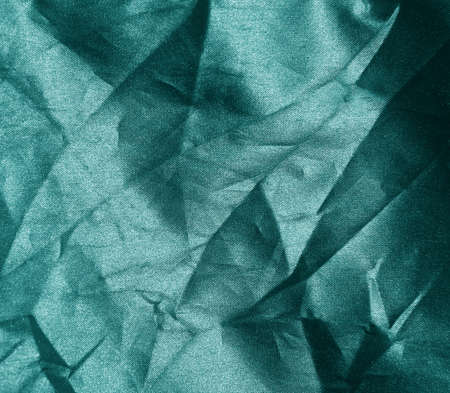 crumpled green fabric background  photo
