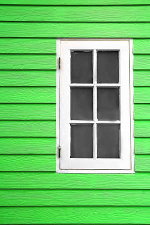 white wood window and green plank wall photo