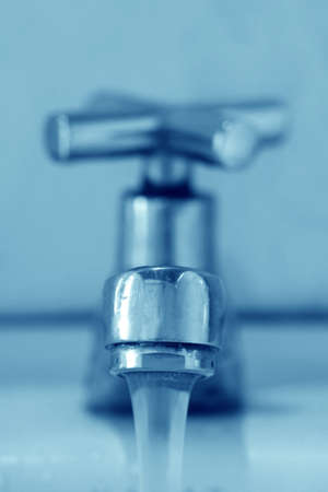 Faucet and water photo