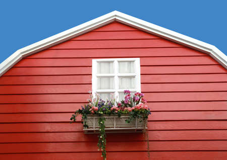 white window with flower on red barn  photo