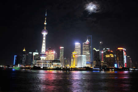 Shanghai tower with full moon night, China