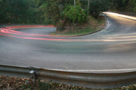 sharp curve road with car light line Stock Photo - 21095506