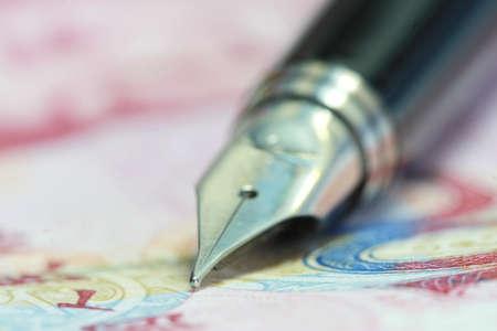 Metal Nib Pen on china money bill photo