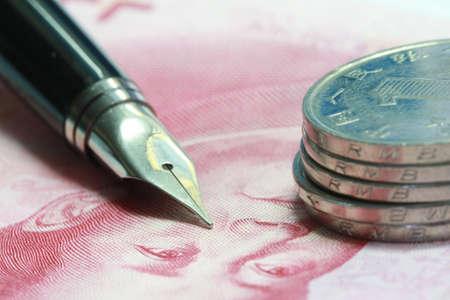Metal Nib Pen on china money bill and coin photo