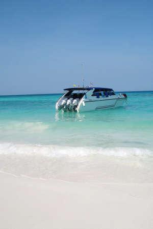speed boat on beach photo