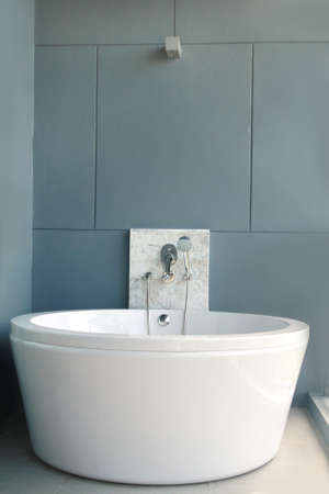 White bath on a gray background, bathtub photo