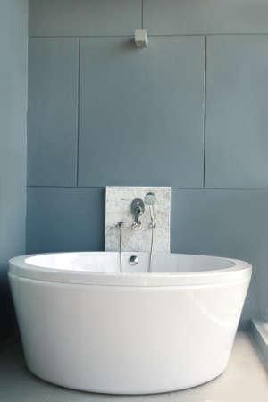 White bath on a gray background, bathtub