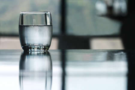 cold drinking water glass on table photo