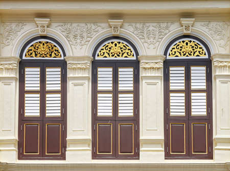 wooden facade: vintage window on wall