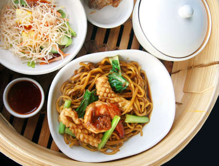 Chinese noodle stir with squid and shrimp photo