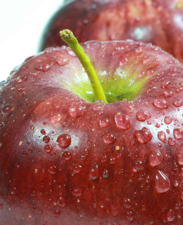 water drop on red apple surface  photo