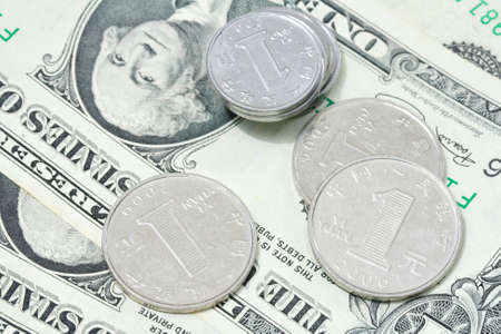 bejing: Yuan coins on dollar bill  Stock Photo