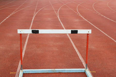 a hurdles on red running tracks  photo