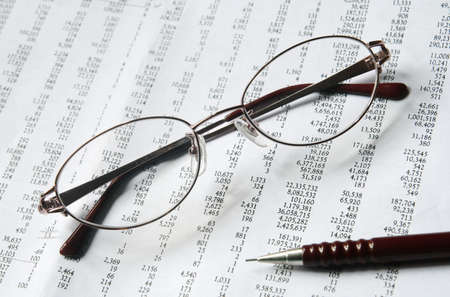 outgoings: eyeglasses and pencil on document Stock Photo