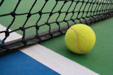 tennis on court with net Stock Photo