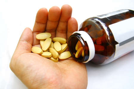 pills, medication at hand