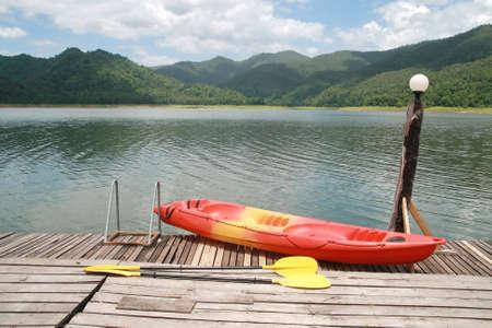 kayaker: Red kayak with mountain and lake