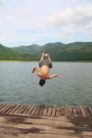 a man jump to river