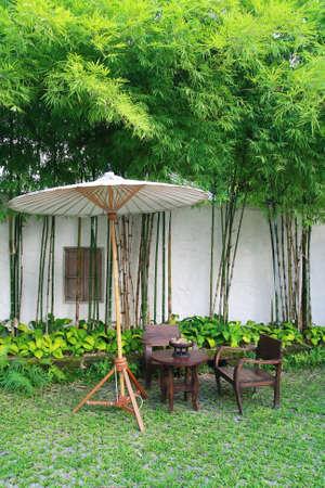 mai: chair set and umbrella in garden, Chiang Mai, Thailand  Stock Photo