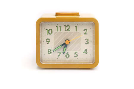 yellow clock isolated  photo