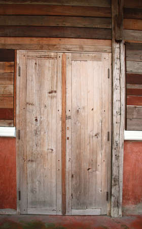 old wood door and plank wall  Stock Photo - 21096775