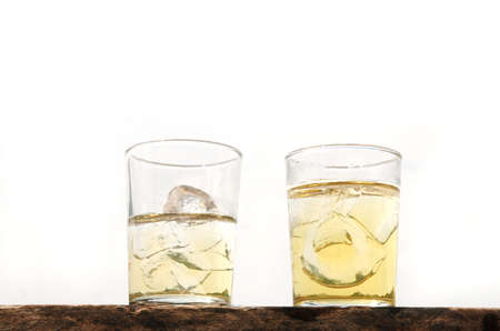 skoal: two lager beer with ice glass on wood isolated  Stock Photo