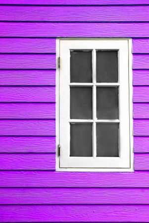 white wood window and purple wall photo