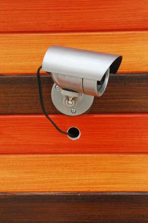 Security camera on wood wall  photo