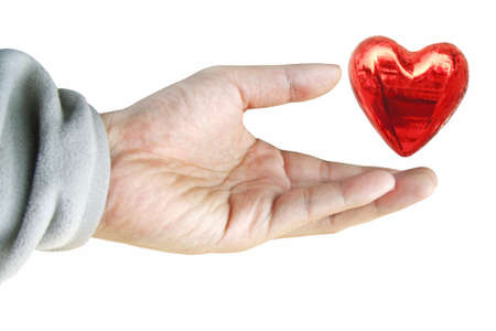 Hand holding red heart