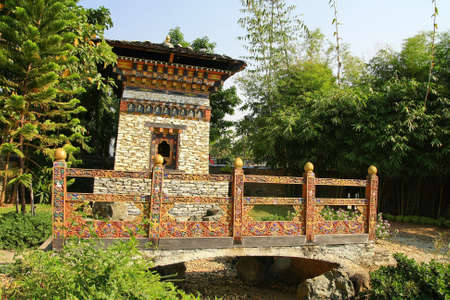 Bell Tower with bridge ,Bhutan  photo