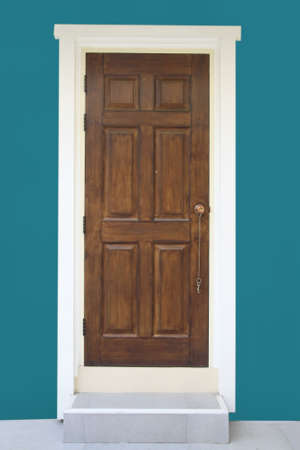 brown wood door with green wall  photo