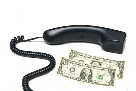 Phone hang and dollar bills  Stock Photo - 21097928