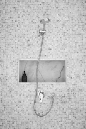 shower on small tile wall