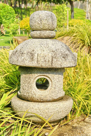 Japanese stone lamp in garden  photo