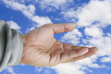 human hand holding on summer sky  photo