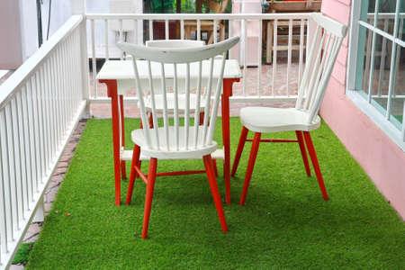 white wood table on grass  Standard-Bild