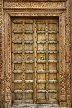Wooden door with ancient floral patten. Wood carving technic photo