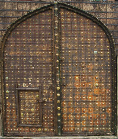 vintage rusty arch door , old gate photo