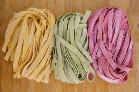 colorful pasta fettuccine on wood photo