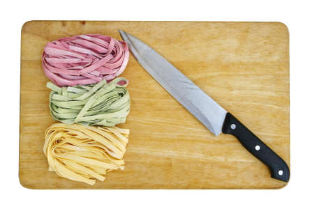 colorful pasta fettuccine and knife  photo