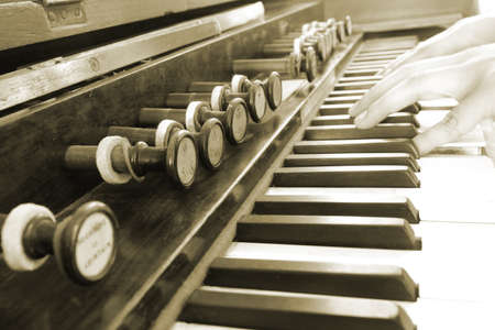 close up hand play vintage piano background photo