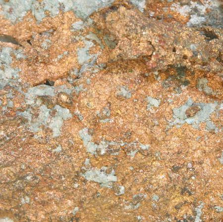 inclusions: close up copper mineral in stone surface