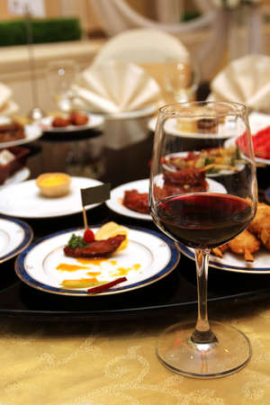 close up red wine glass and food photo